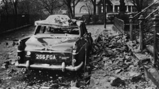 15th January 1968: A car damaged by falling debris in Glasgow after gales of 103 miles per hour swept Scotland, killing over 20 people.