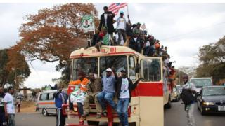 """Supporters of Edgar Lungu""""s Patriotic Front party (PF), arrive to attend a rally on Wednesday ahead of the presidential elections in the capital, Lusaka, Zambia."""