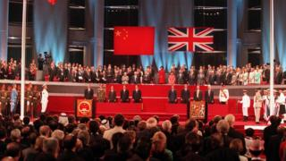 A general view of the handover ceremony showing the Chinese flag (L) flying after the Union flag (R) was lowered in Hong Kong in this July 1, 1997 file photograph.