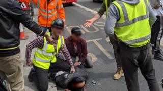 Members of the public restrain the suspected attacker