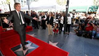 Hugh Laurie with his star on the Hollywood Walk of Fame