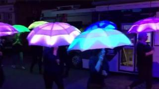 Volunteers performed as part of The Umbrella Project along Queen Street for Hull's ninth Freedom Festival