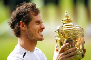 Andy Murray of Great Britain lifts the trophy