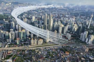 Red Arrows perform a flypast over Kuala Lumpur city centre around the Petronas towers