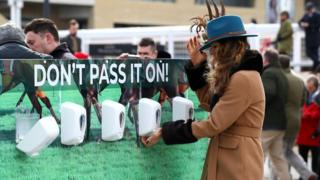Technology Racegoers use hand sanitiser installed at Cheltenham Racecourse