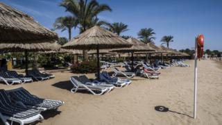 Empty sun loungers on a beach in the Sharm el-Sheikh resort