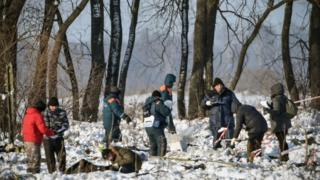 Russian Emergency Ministry rescuers work at the site of a plane crash which occurred the day before in Ramensky district, on the outskirts of Moscow