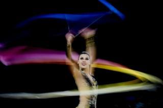 Diamanto Evripidou of Cyprus performs during the rhythmic gymnastics ribbon final of the XXI Commonwealth Games at the Gold Coast, Australia,