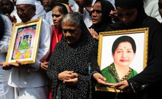 Indian Muslims hold a portrait of Tamil Nadu Chief Minister Jayalalitha Jayaram as they pray for her wellbeing as they stand in front of a hospital where she was being treated in Chennai on October 5, 2016. Jayalalithaa was hospitalised after complaining of fever and dehydration.