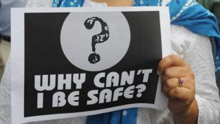 "Woman holds a poster that says ""why can't I be safe?"" during a protest in Mumbai"