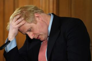 in_pictures British Prime Minister Boris Johnson speaks during a news conference inside 10 Downing Street