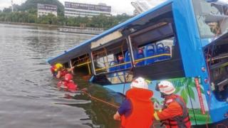 China: Bus plunges into reservoir, killing 21