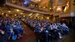An audience watches a screening of a new film at SXSW
