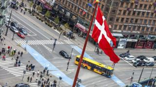 A Danish flag on a pole in central Copenhagen