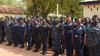 Ghana Police Officers dey stand attention