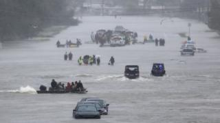 An image showing residents waiting to be rescued from the flood waters of Tropical Storm Harvey
