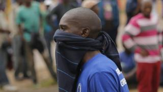 A man with a jumper of his month protests in an anti-foreigner march in Pretoria, South Africa - Friday 24 February 2017