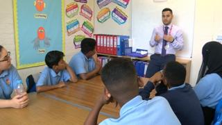 Hamed Amiri speaking to pupils