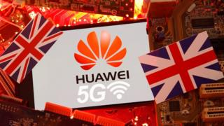 The union flag and Huawei logo on a PC motherboard