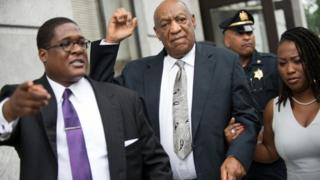 Mr Cosby (centre) alongside his two spokespeople outside the suburban Philadelphia courthouse