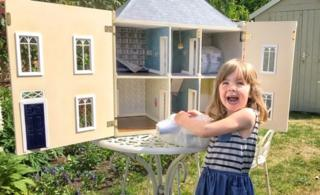 Girl with dolls' house