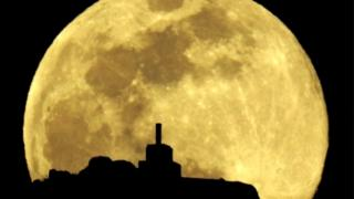 A view of the full moon over Mount Pico Sacro in Spain