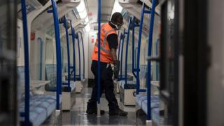 Tube worker cleaning a carriage