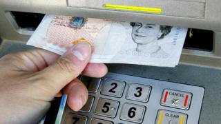 Man withdrawing money from cash machine