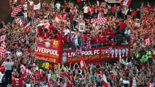 The Liverpool team ride on an open top bus through a mass of fans as they arrive at St. George's Hall during the Liverpool Champions League Victory Parade on May 26, 2005 in Liverpool, England.