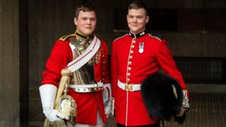 Guardsman Thomas Dell of the Grenadier Guards (right) and his twin brother Trooper Ben Dell of the Household Cavalry,