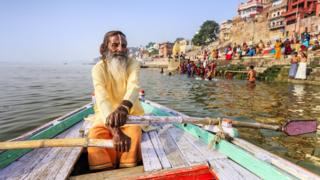 Man-rowing-on-the-river-Ganges.