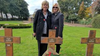 The two sisters and Pte Hanlon's grave