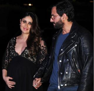 Indian Bollywood actors Saif Ali Khan (R) and Kareena Kapoor Khan pose for a photograph in Mumbai on December 5, 2016