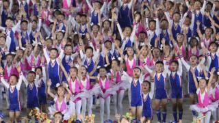 North Koreans perform gymnastic and artistic during a South Korean President Moon Jae-in and North Korean leader Kim Jong Un visit at the May Day Stadium on September 19, 2018