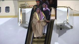 King Salman disembarks plane via gold escalator