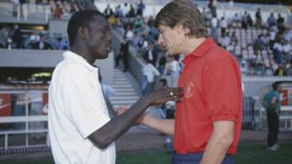 George Weah (left for 1993) say Arsène Wenger (right) take care of am like im pikin