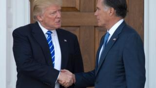 Donald Trump shakes hands with Mitt Romney