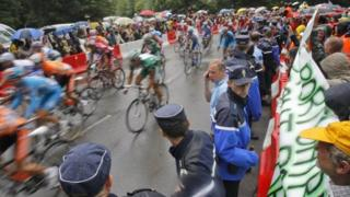 French police hold back demonstrating harbour workers during the third stage of the Tour de France (file photo, July 2008)