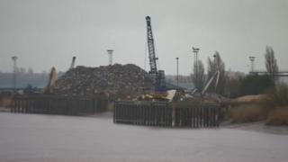 Crane and other machinery at a port in Gunness