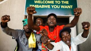Supporters of Zimbabwe's ruling ZANU-PF party react after Zimbabwe's top court threw out an opposition bid to overturn presidential election results in favour of the ZANU-PF candidate on August 24, 2018, in Harare.