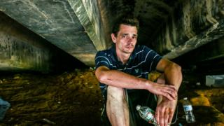 Addicts gather under the bridges along the freight track, away from the public eye