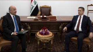Iraqi President Barham Saleh (left) tasked Adnan al-Zurfi (right) with forming a new government