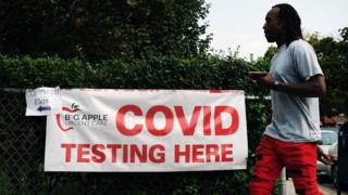 science A sign directs people to a Covid-19 testing site on 14 September 2020 in the Brooklyn borough of New York City