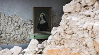 A painting sketches Santa Rita da Cascia inside S. Maria della Cona church devastated by a quake in Frascaro, Umbria region, Italy, 2 November 2016.