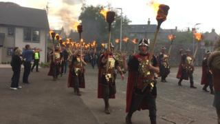 Vikings from Shetland lead a torch parade during the Traditional Boats Festival in Portsoy, Aberdeenshire, at the weekend.