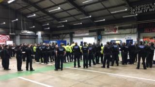 Police briefing before raids