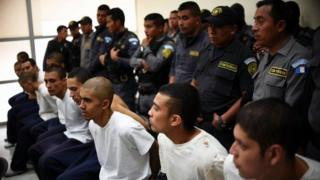 Inmates of the Male Juvenile Detention Centre attend a hearing at a court in Guatemala City on March 21, 2017.