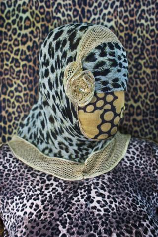 Bangladeshi woman with face covered in leopard print