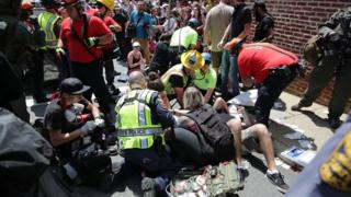 Emergency services treat the injured after a car drove into anti-fascist demonstrators in Charlottesville