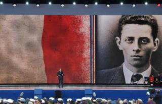 French President Emmanuel Macron on stage